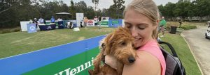 Olivia Marlow and puppy Arlo, watch fiance Jordan Zunic tee off this morning