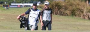 Golfer and Caddie walking up fairway
