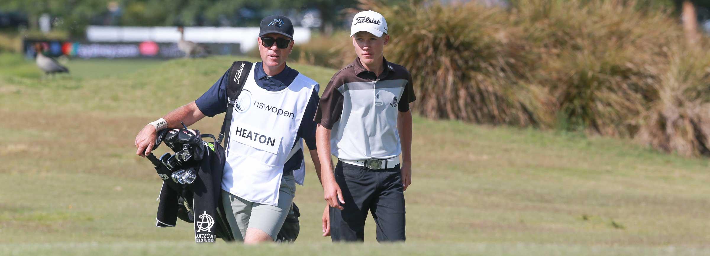 Golfer and Caddie walking up fairway