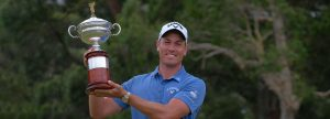 Anthony Quayle holds aloft the North Coast Open Trophy