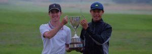 boys holding trophy