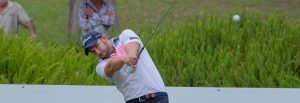 Golfer watches a tee shot dubbo beckons for fraser wood